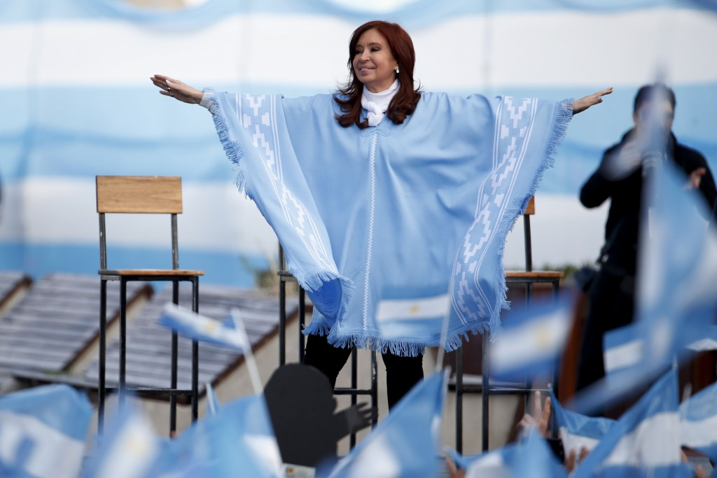In this Oct. 27, 2019 file photo, Cristina Fernandez, who went on toe win Argentina's vice presidency, waves to supporters at a closing campaign rally...