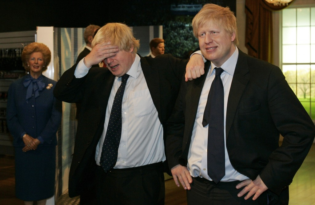 FILE - In this Tuesday, May 5, 2009 file photo then Mayor of London Boris Johnson, left, poses with a wax figure of himself at Madame Tussauds wax mus...