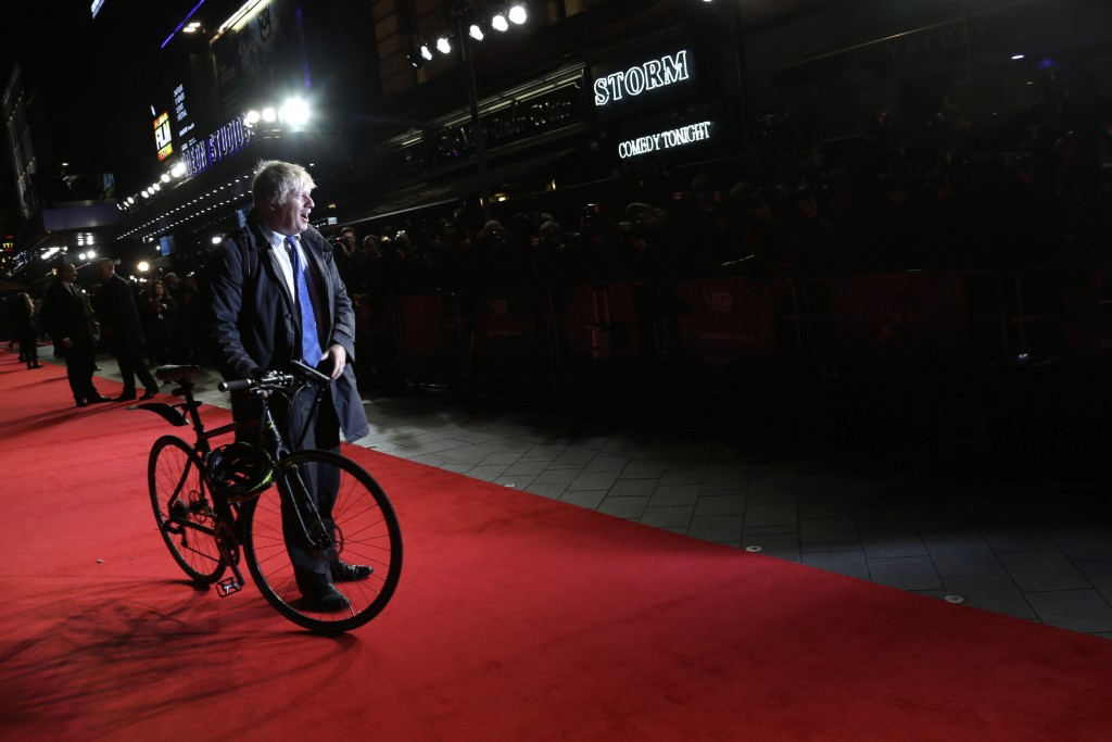 FILE - In this Tuesday, Oct. 14, 2014 file photo London mayor Boris Johnson poses for photographers upon arrival at the premiere of the film Testament...