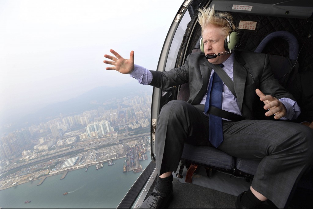 FILE - In this Thursday Oct. 17, 2013 file photo Mayor of London Boris Johnson looks at the skyline during helicopter ride over Hong Kong. (AP Photo/A...