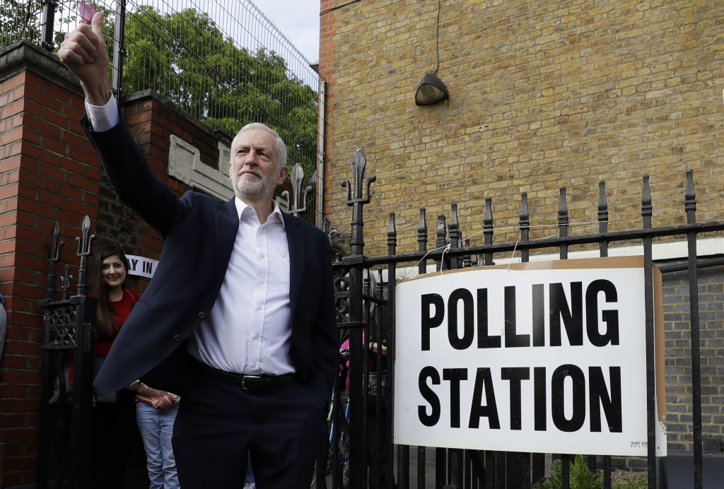 FILE - In this Thursday, May 23, 2019 file photo Jeremy Corbyn leader of Britain's opposition Labour Party gestures after voting in the European Elect...