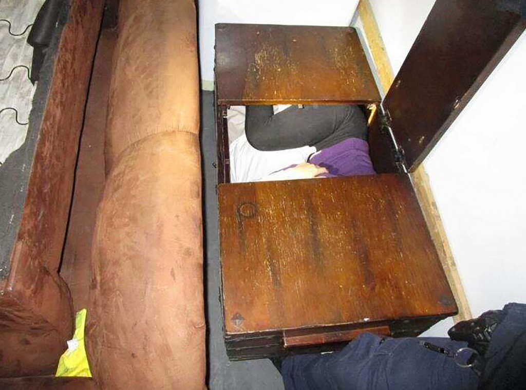 This photo released Monday, Dec. 9, 2019 by U.S. Customs and Border Protection (CBP) shows a person hiding inside a wooden chest, among 11 Chinese nat...