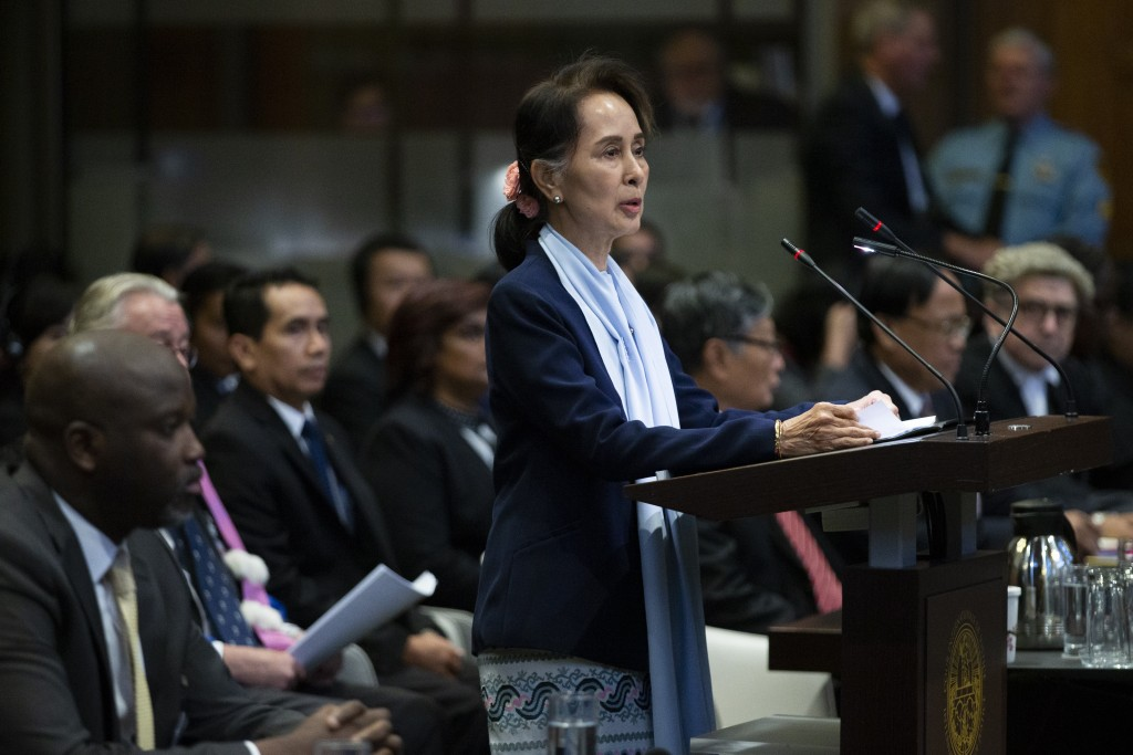 Myanmar's leader Aung San Suu Kyi addresses judges of the International Court of Justice as Gambia's Justice Minister Aboubacarr Tambadou, left, liste...