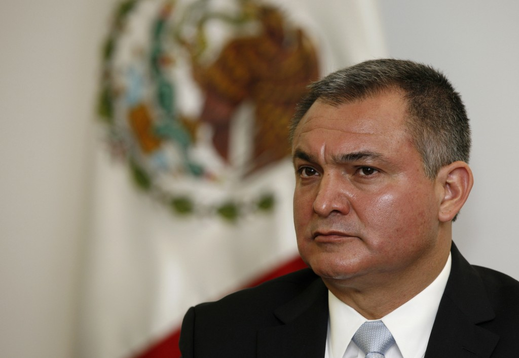 FILE- In this Oct. 8, 2010 file photo, Mexico's Secretary of Public Safety Genaro Garcia Luna attends a press conference on the sidelines of an Americ...