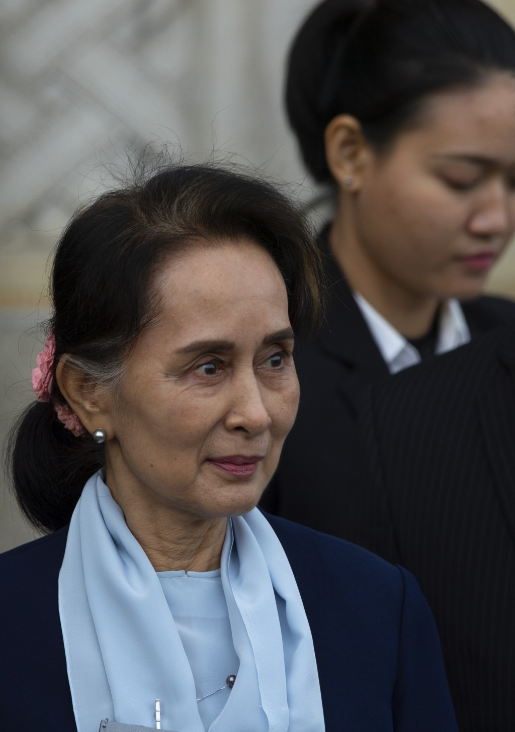 Myanmar's leader Aung San Suu Kyi leaves the International Court of Justice after addressing judges on the second day of three days of hearings in The...