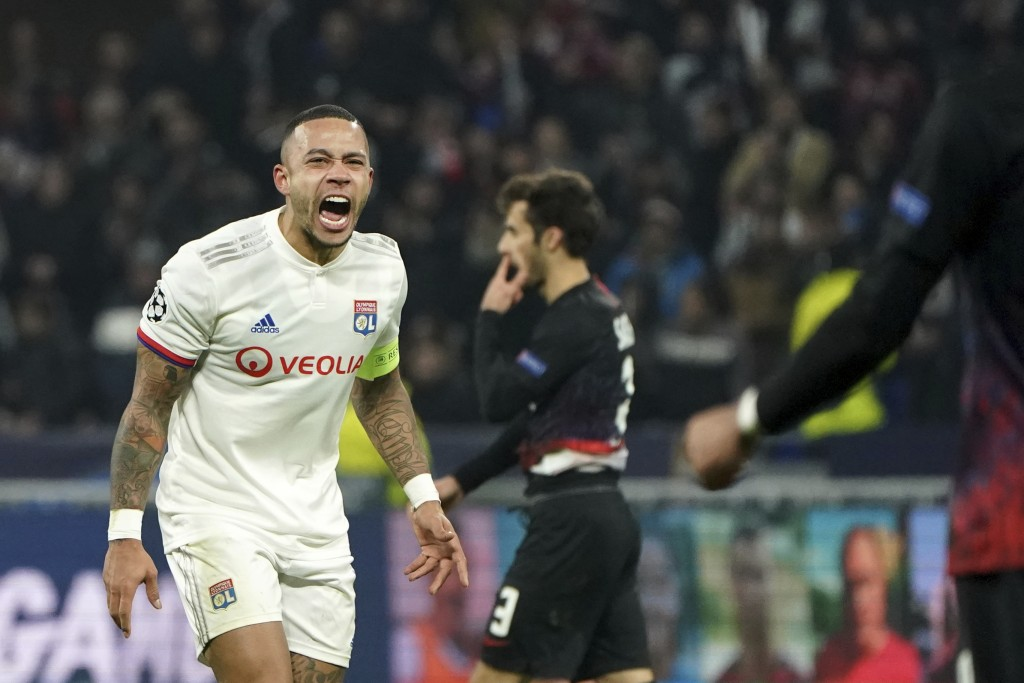 Lyon's Memphis Depay celebrates at the end of the match during the group G Champions League soccer match between Lyon and RB Leipzig at the Lyon Olymp...
