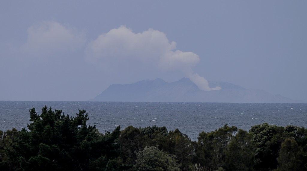 Plumes of steam rise above White Island off the coast of Whakatane, New Zealand, Wednesday, Dec. 11, 2019. Survivors of a powerful volcanic eruption i...