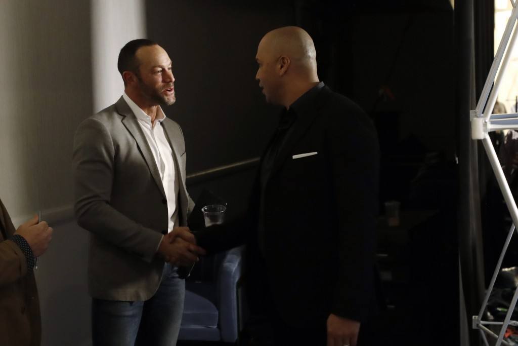 New York Mets manager Carlos Beltran, right, greets San Francisco Giants manager Gabe Kapler between news conferences during the Major League Baseball...
