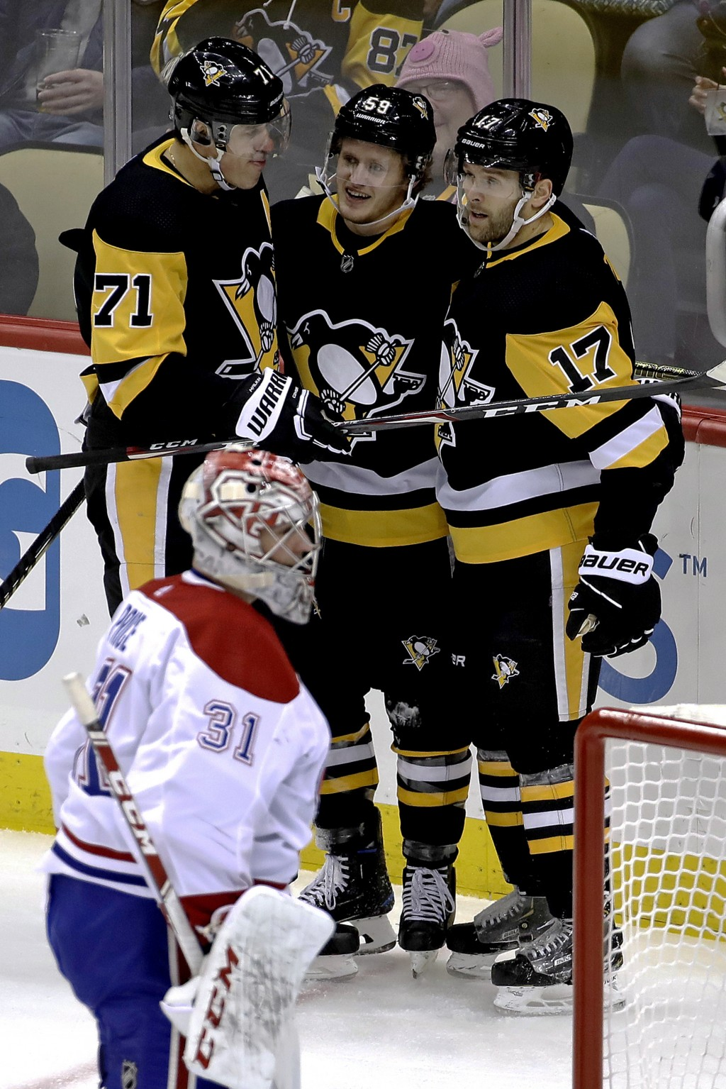 Pittsburgh Penguins' Jake Guentzel (59) celebrates his goal with Evgeni Malkin (71) and Bryan Rust (17) as Montreal Canadiens goaltender Carey Price (...