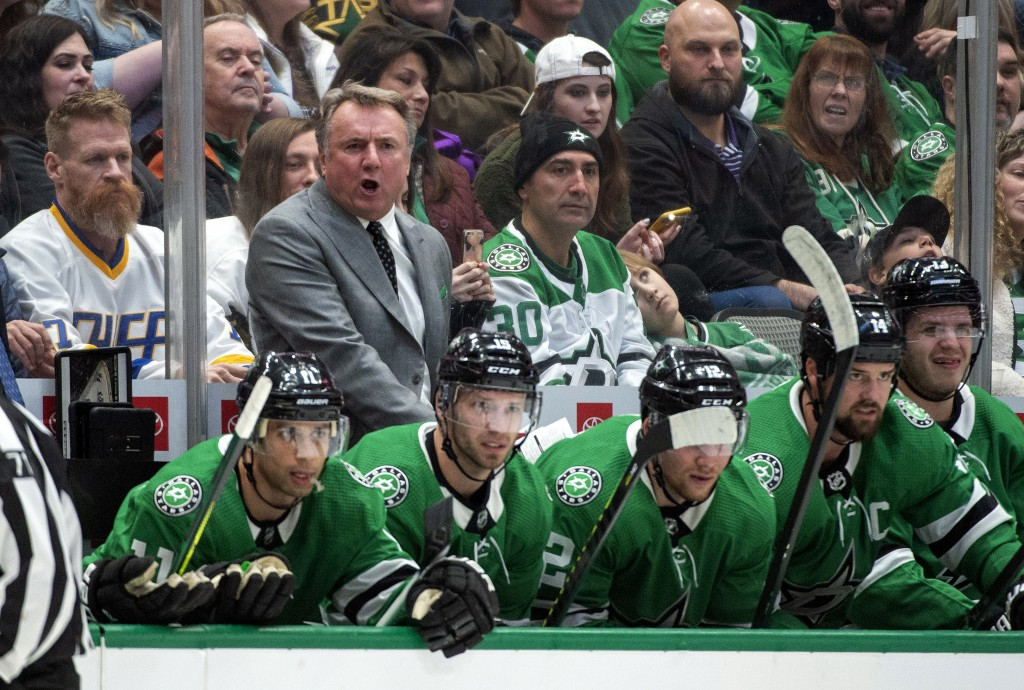 Dallas Stars interim head coach Rick Bowness yells to his players in the first period of an NHL hockey game against the New Jersey Devils, Tuesday, De...