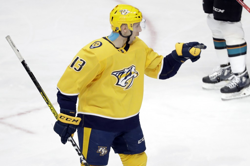 Nashville Predators center Nick Bonino celebrates after scoring a goal against the San Jose Sharks in the third period of an NHL hockey game Tuesday, ...