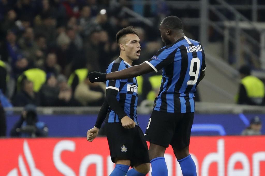 Inter Milan's Romelu Lukaku, right, celebrates with Inter Milan's Lautaro Martinez after scoring his side's opening goal during the Champions League, ...