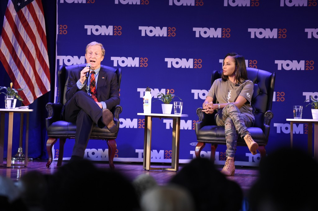Democratic presidential candidate Tom Steyer, left, next to lyricist MC Lyte, right, speaks at a black women's forum on Tuesday, Dec. 10, 2019, at All...