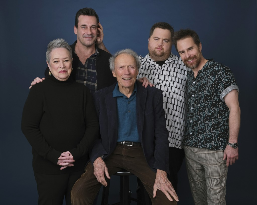 This Dec. 5, 2019 photo shows director Clint Eastwood, center, posing with cast members, from left, Kathy Bates, Jon Hamm, Paul Walter Hauser and Sam ...