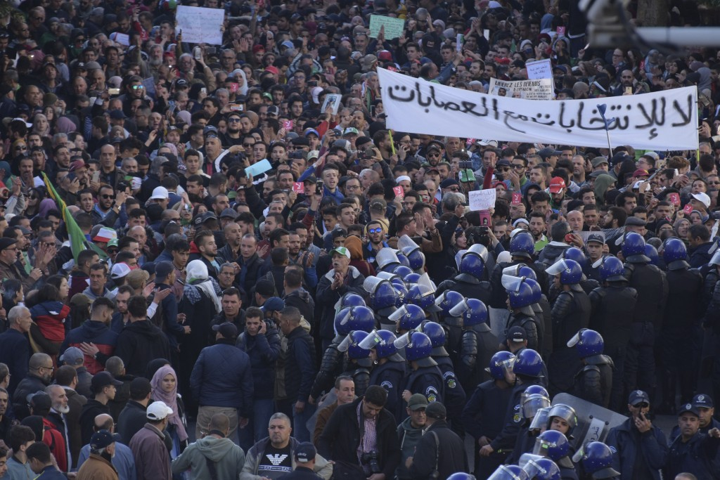 Algerian demonstrators take to the streets in the capital Algiers to protest against the government and reject the upcoming presidential elections, in...