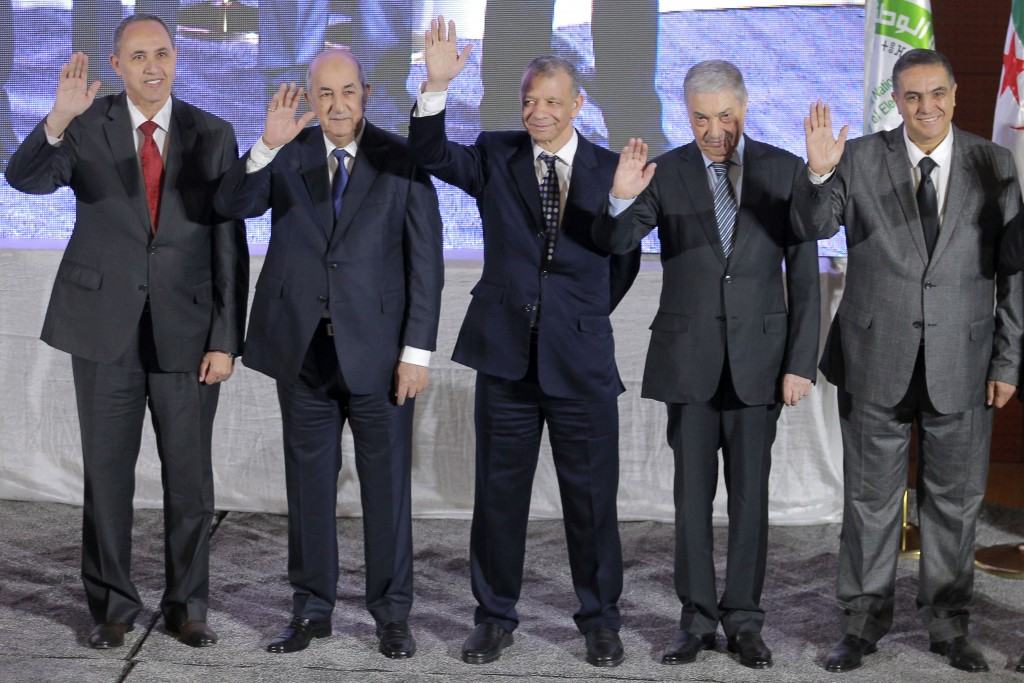 FILE - In this Oct. 17, 2019 file photo, the five candidates for the upcoming Dec. 12, presidential election, from left to right, Azzedine Mihoubi, Ab...