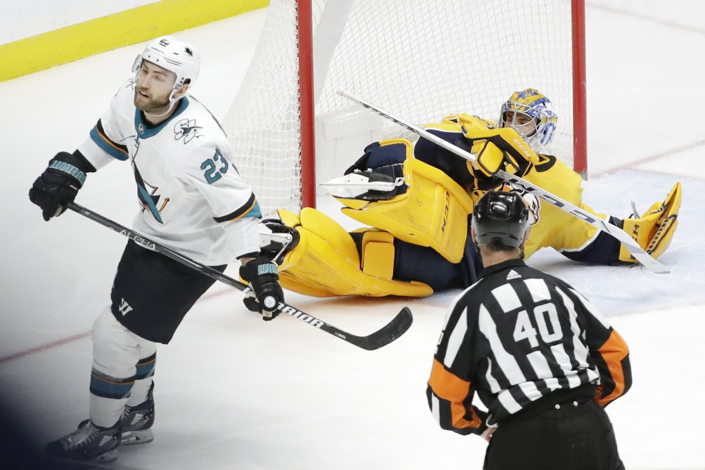 Nashville Predators goaltender Juuse Saros, of Finland, falls to the ice after stopping a penalty shot by San Jose Sharks center Barclay Goodrow (23) ...