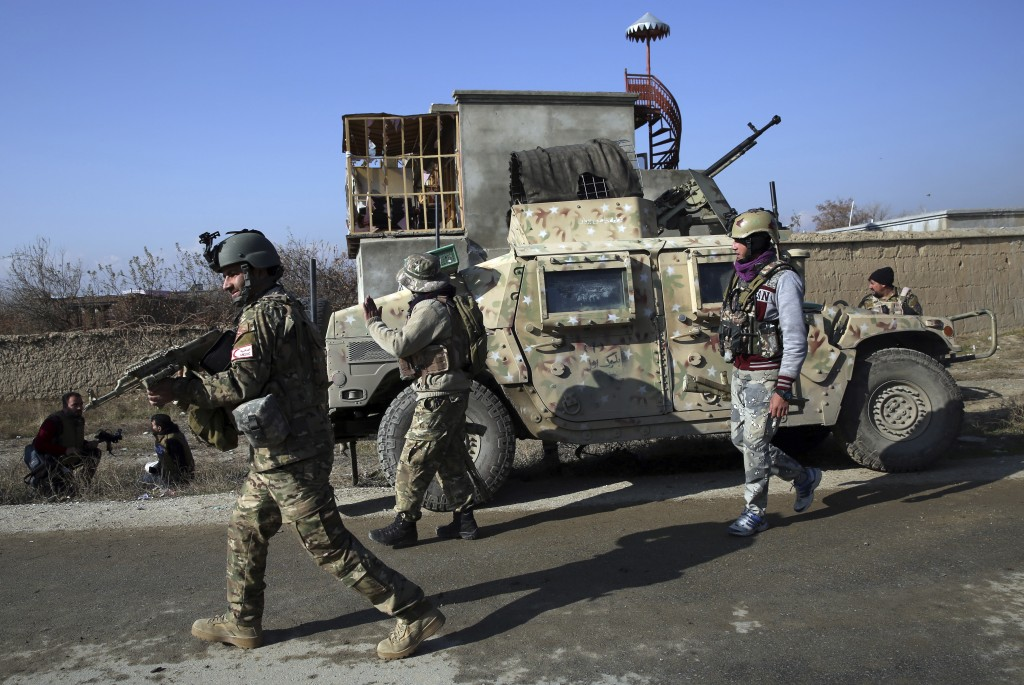 Security personnel arrive near the site of an attack near the Bagram Air Base In Parwan province of Kabul, Afghanistan, Wednesday, Dec. 11, 2019. A po...