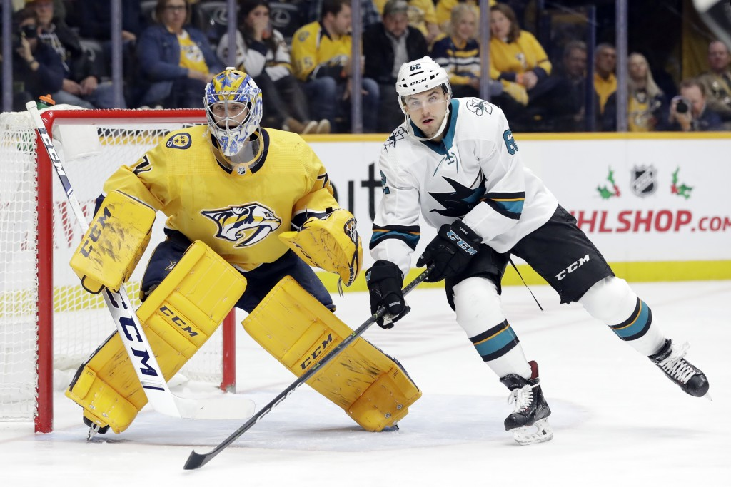San Jose Sharks right wing Kevin Labanc (62) positions himself in front of Nashville Predators goaltender Juuse Saros (74), of Finland, in the first p...