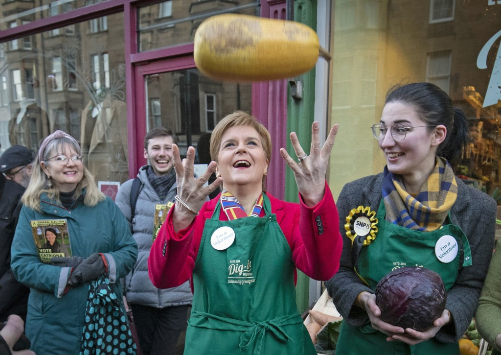 SNP leader Nicola Sturgeon, centre and SNP candidate for Edinburgh South Catriona MacDonald, right, pose for a photo, during a visit to Digin Communit...