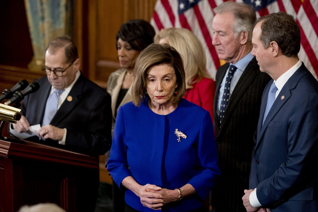 House Speaker Nancy Pelosi of Calif., center, accompanied by Chairman of the House Judiciary Committee Jerrold Nadler, D-N.Y., left, Chairwoman of the...