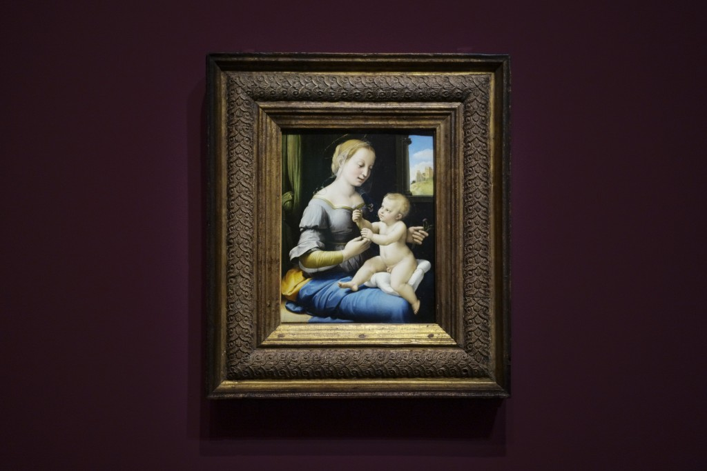 The painting 'Madonna of the Pinks' of Renaissance artist Raphael from London's National Gallery is on display at an exhibition at the Gemaeldegalerie...