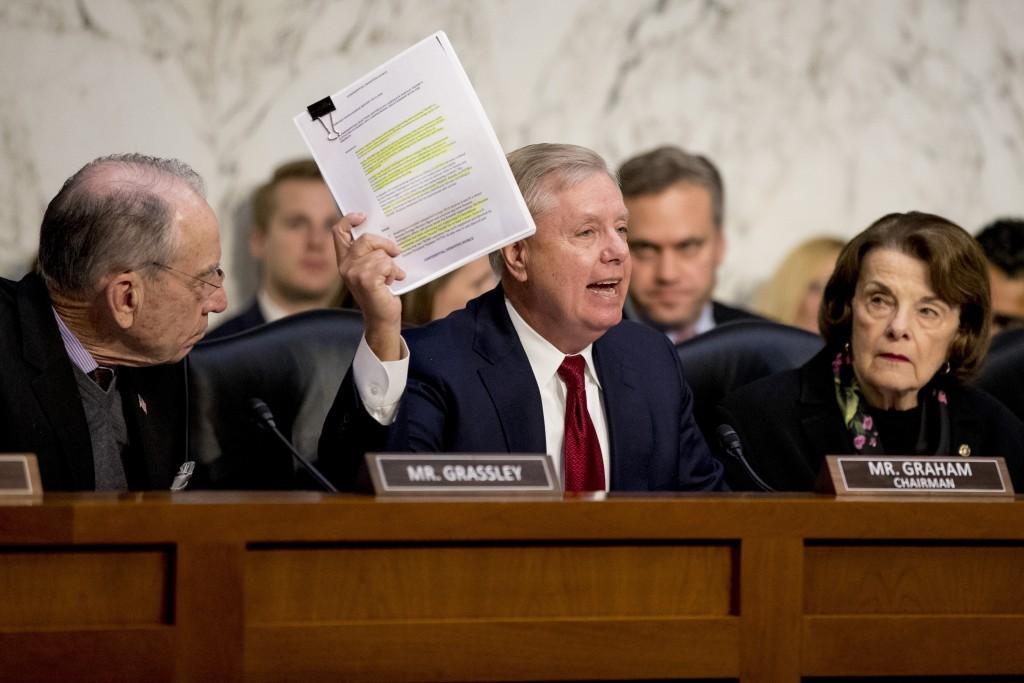 Chairman Lindsey Graham, R-S.C., center, accompanied by Sen. Chuck Grassley, R-Iowa, left, and Ranking Member Sen. Dianne Feinstein, D-Calif., right, ...