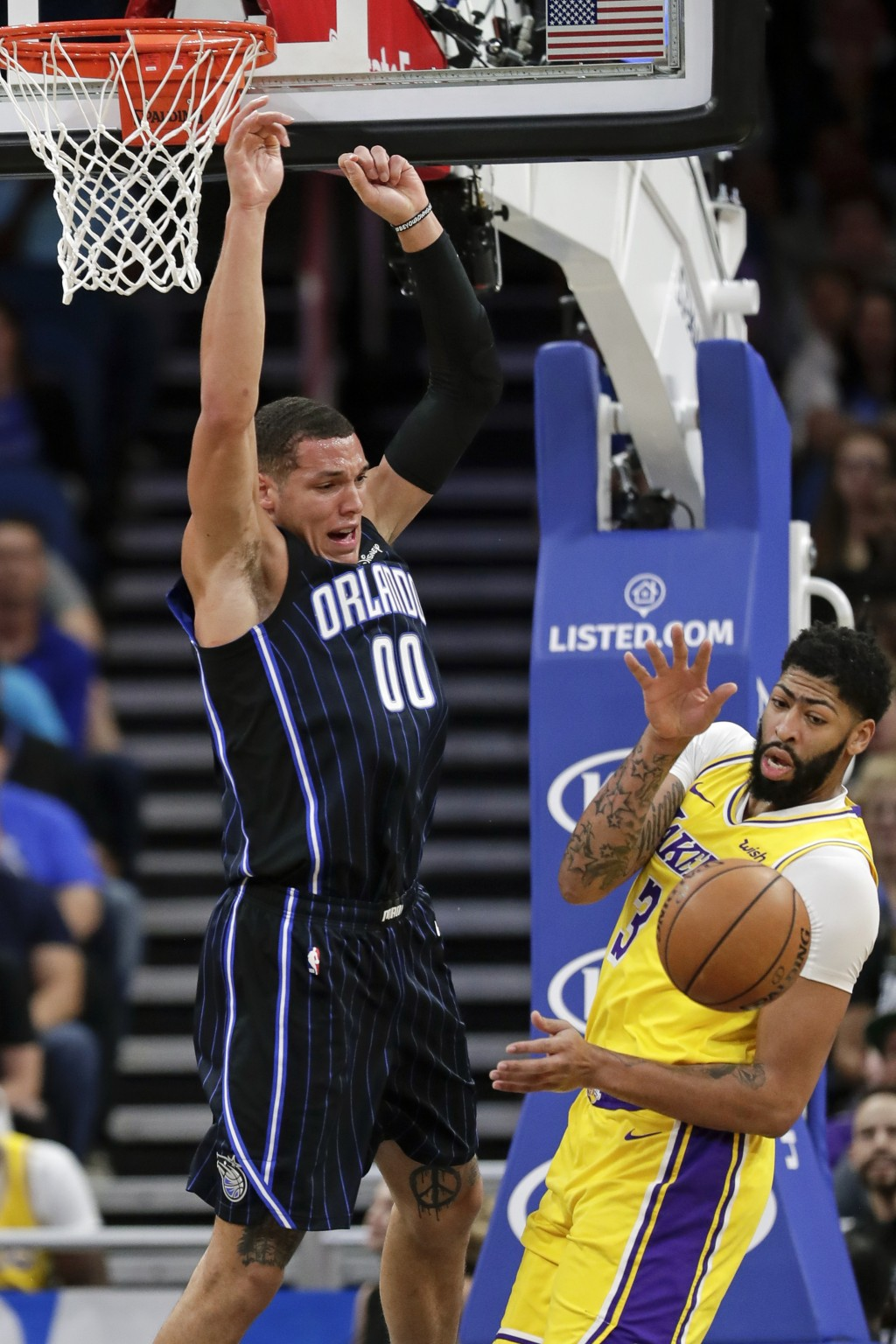 Orlando Magic's Aaron Gordon (00) loses the ball as he goes up for a shot against Los Angeles Lakers' Anthony Davis, right, during the first half of a...