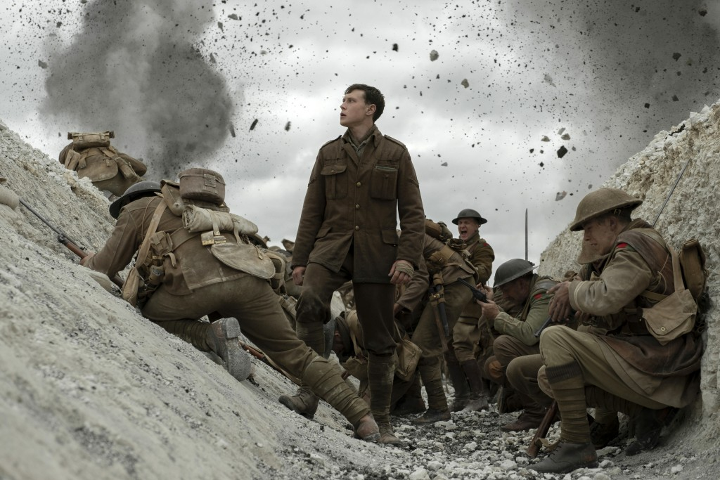 "This image released by Universal Pictures shows George MacKay, center, in a scene from ""1917,"" directed by Sam Mendes. (François Duhamel/Universal Pic..."