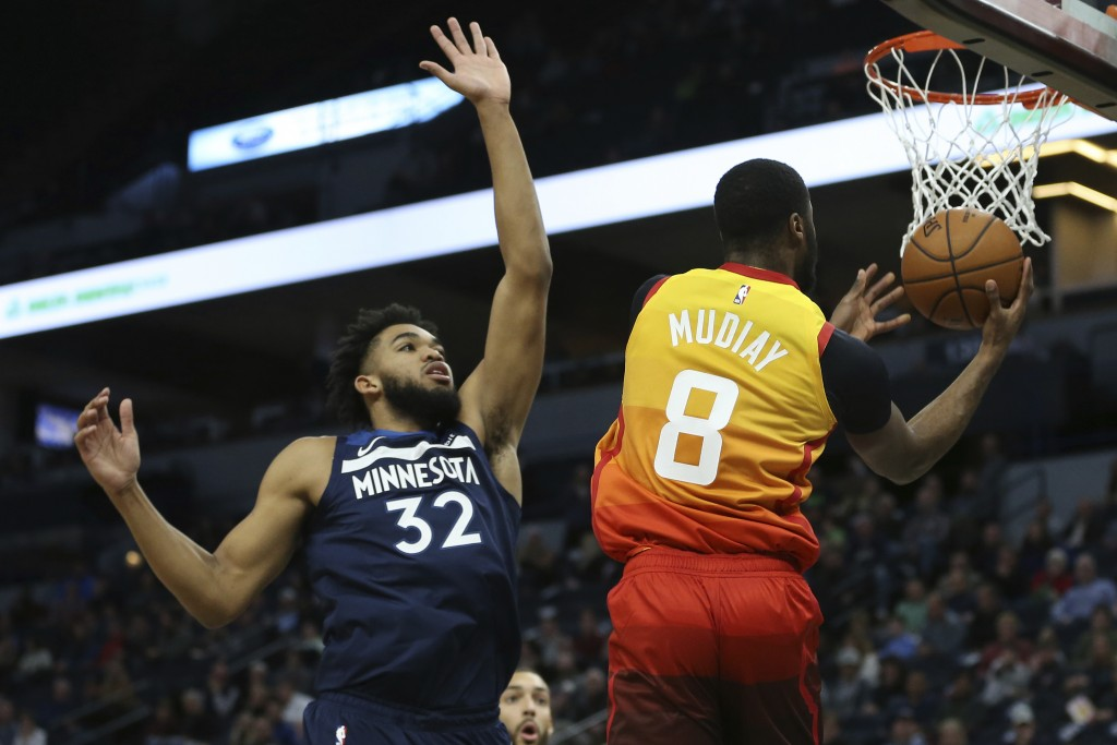 Utah Jazz's Emmanuel Mudiay goes up to the basket against Minnesota Timberwolves' Karl-Anthony Towns in the first half of an NBA basketball game Wedne...