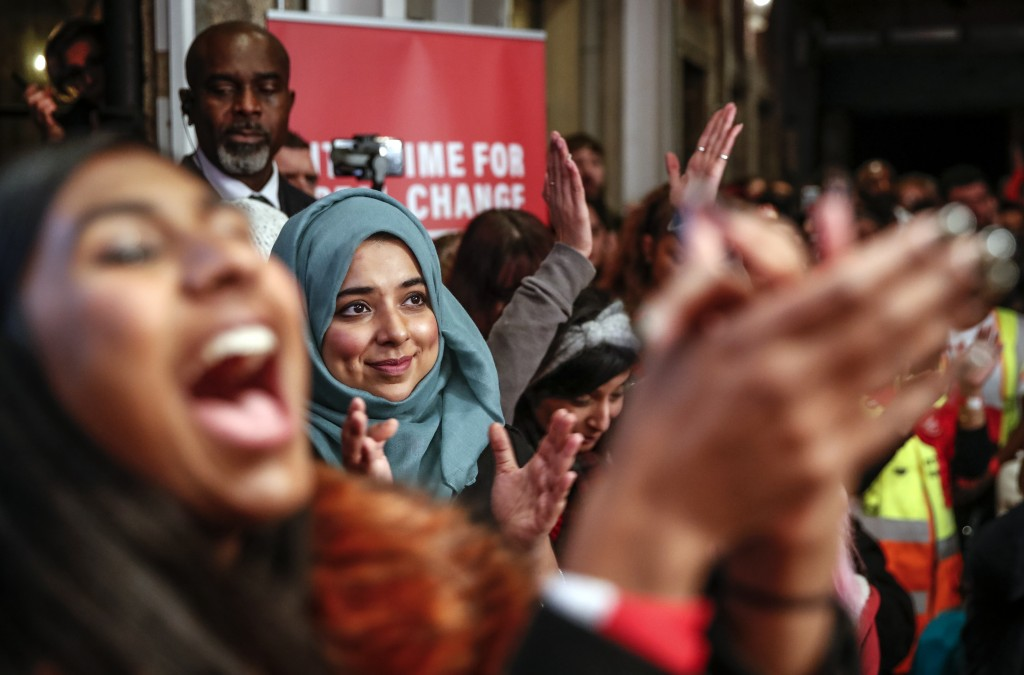 Supporters cheer as Labour Leader Jeremy Corbyn addresses an eve of poll rally in London, Wednesday, Dec. 11, 2019. Britain will go to the polls tomor...
