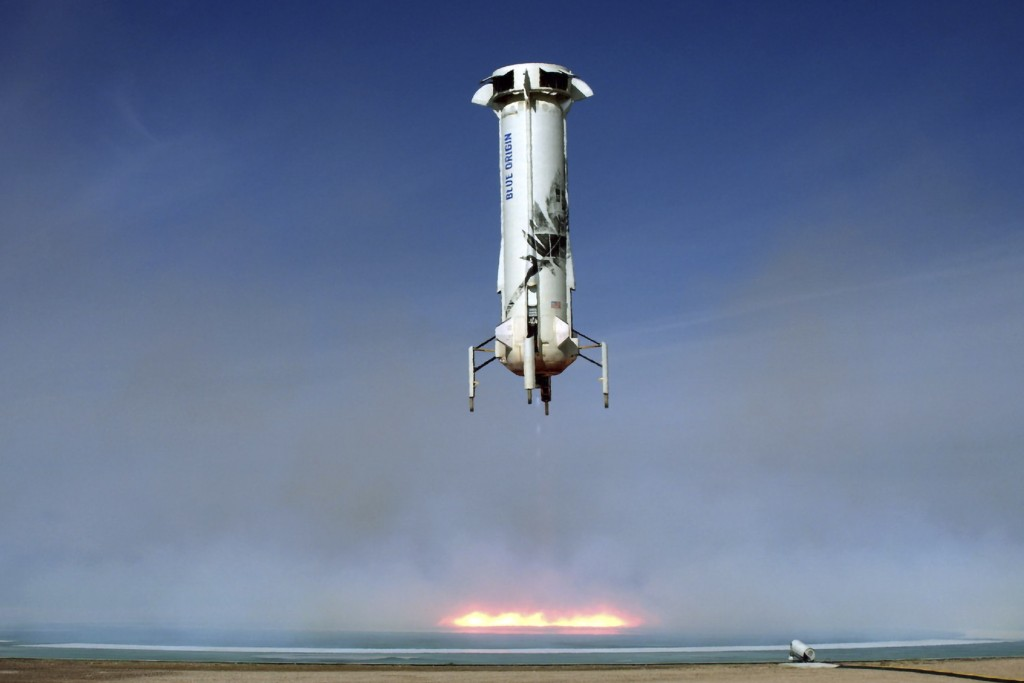 In this image provided by Blue Origin, the New Shepard rocket booster lands near Van Horn, Texas. Blue Origin, Jeff Bezos' space company, has scored a...