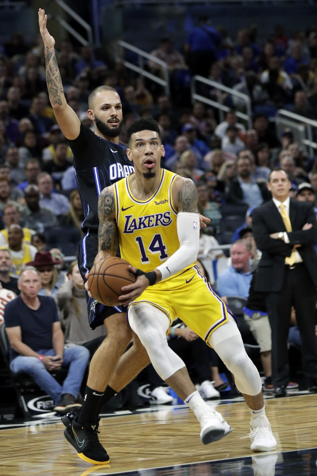 Los Angeles Lakers guard Danny Green (14) gets in front of Orlando Magic guard Evan Fournier, left, as he goes to the basket during the first half of ...