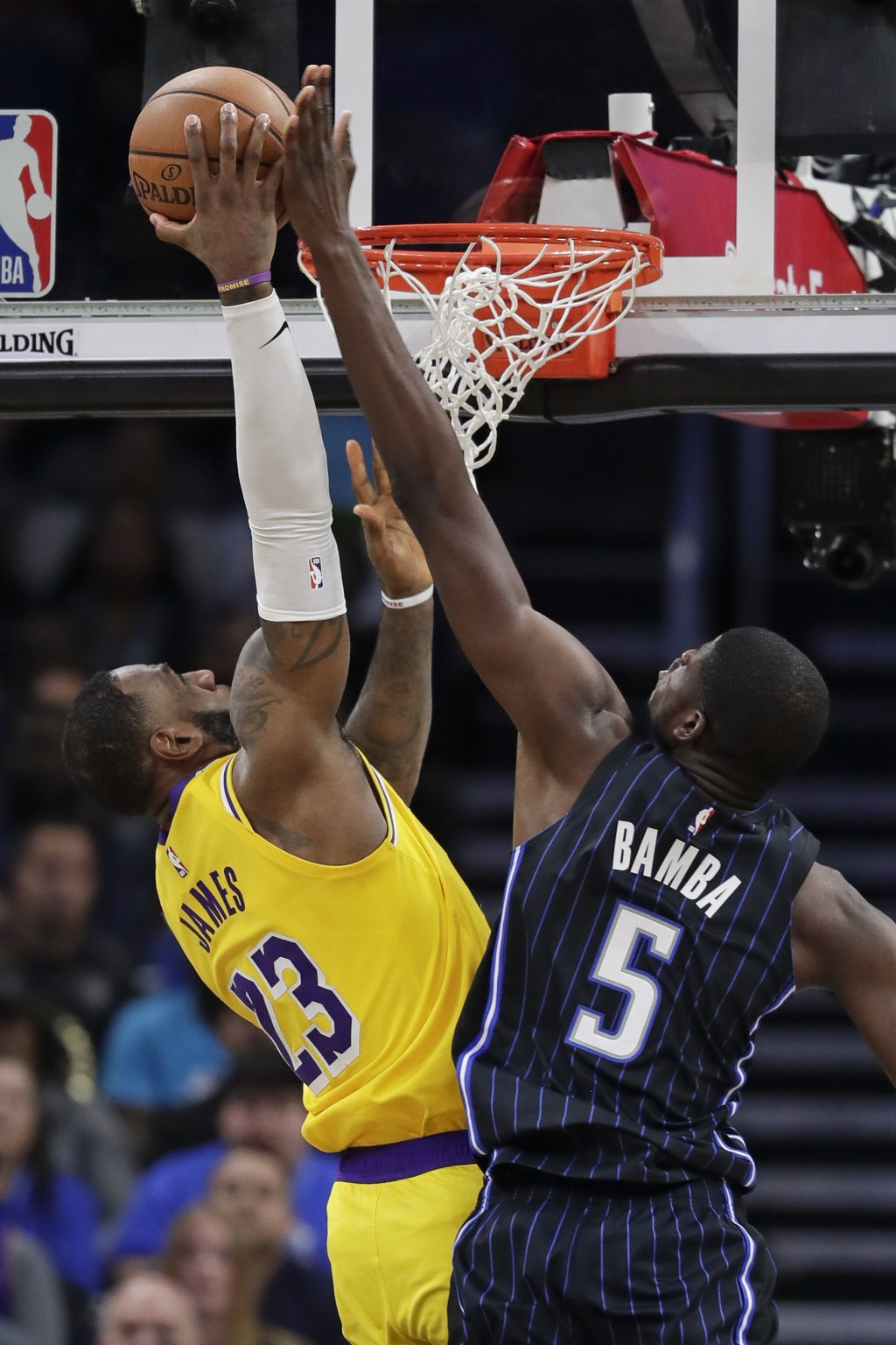 Orlando Magic's Mo Bamba (5) blocks a shot by Los Angeles Lakers forward LeBron James (23) during the second half of an NBA basketball game, Wednesday...