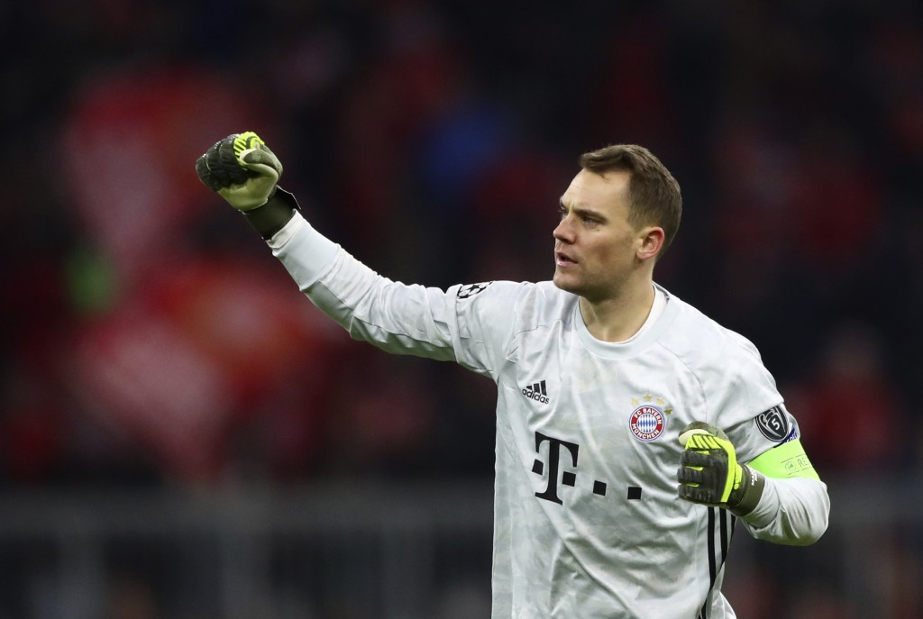 Bayern's goalkeeper Manuel Neuer celebrates after Bayern's Thomas Mueller scored his teams second goal during the Champions League group B soccer matc...