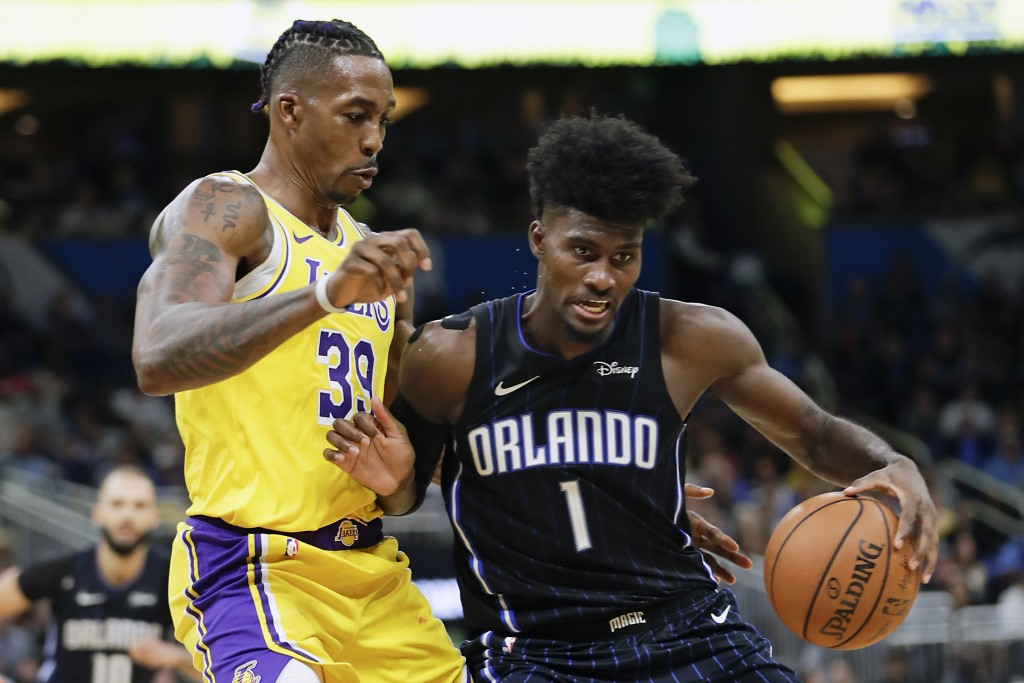 Orlando Magic's Jonathan Isaac (1) looks for a path to the basket against Los Angeles Lakers' Dwight Howard, left, during the second half of an NBA ba...
