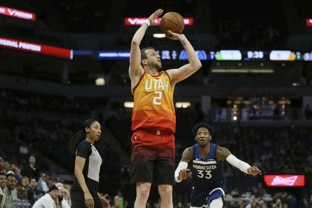 Utah Jazz's Joe Ingles shoots the ball in the first half of an NBA basketball game against the Minnesota Timberwolves, Wednesday, Dec. 11, 2019, in Mi...