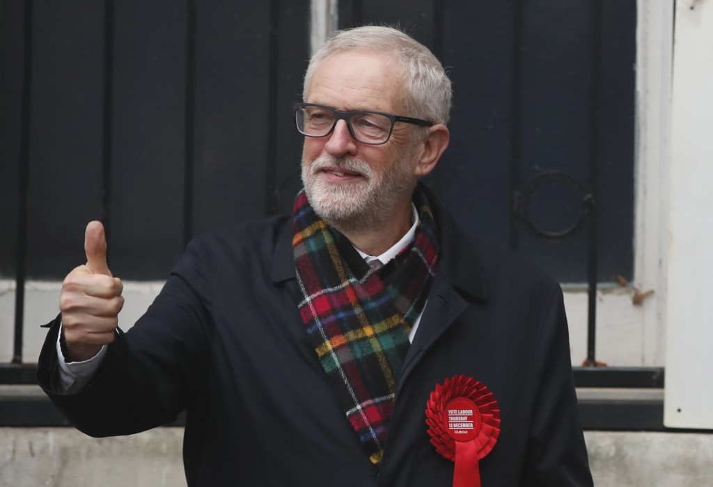 British opposition Labour Party leader Jeremy Corbyn, gestures after casting his vote in the general election, in Islington, London, England, Thursday...