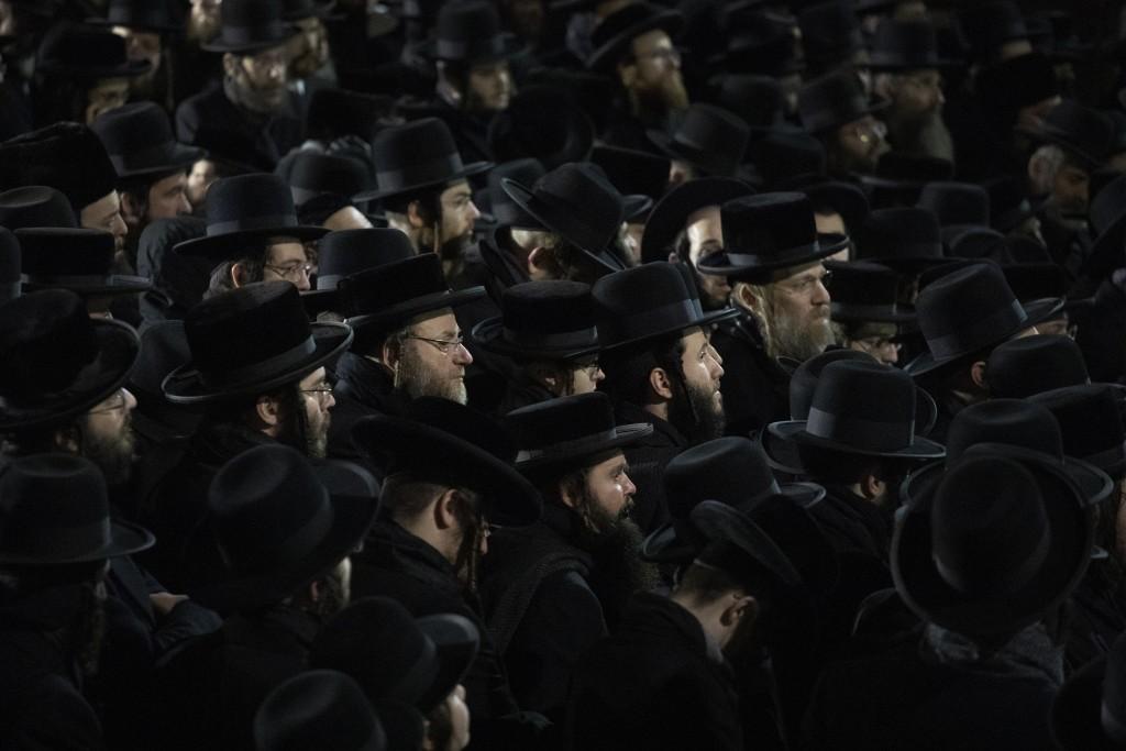 Orthodox Jewish men attend Moshe Deutsch's funeral, Wednesday, Dec. 11, 2019 in the Williamsburg neighborhood of New York. Deutsch was killed Tuesday ...