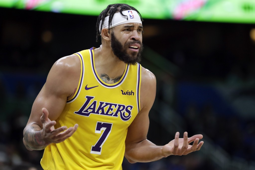 Los Angeles Lakers center JaVale McGee (7) questions a call by officials during the first half of an NBA basketball game against the Orlando Magic, We...