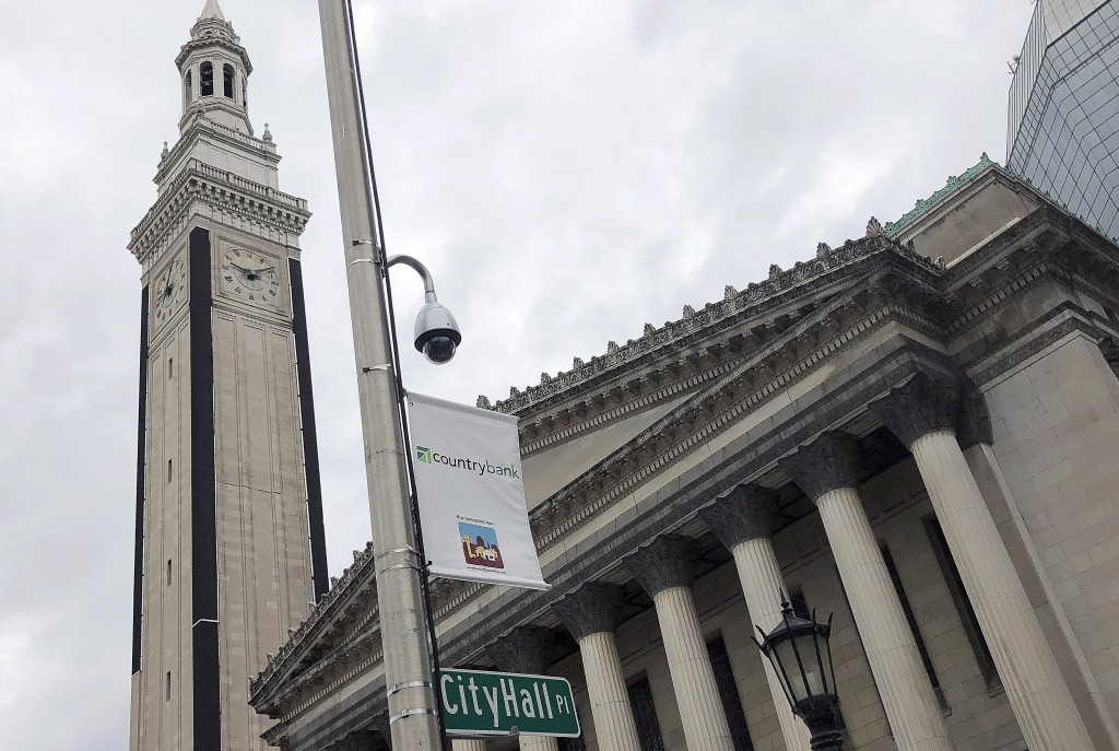 In this Thursday, Oct. 17, 2019 photo, a video surveillance camera hangs on a pole outside City Hall in Springfield, Mass. Some city councilors are pu...