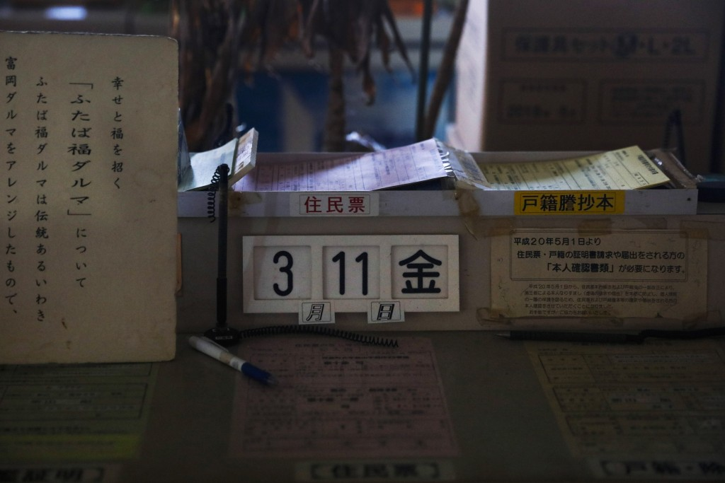 A calendar in an abandoned town hall office shows Friday, March 11, the date of the 2011 earthquake and tsunami that crippled the nearby Fukushima Dai...