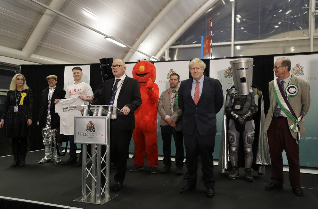 Britain's Prime Minister and Conservative Party leader Boris Johnson stands on stage with other candidates during the Uxbridge and South Ruislip const...