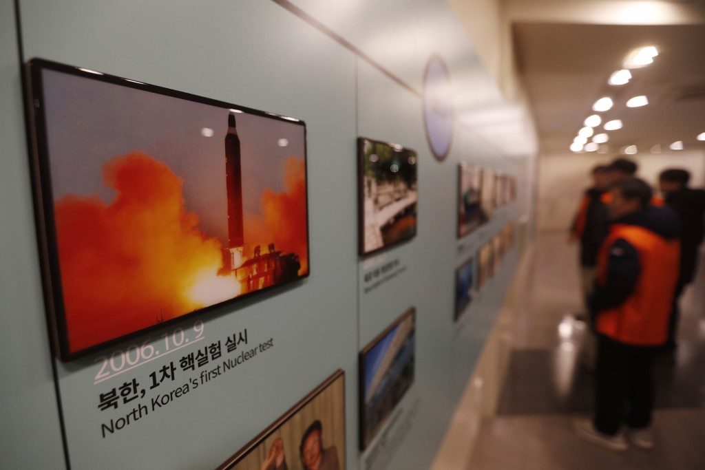 A photo showing North Korea's missile launch is displayed at the Unification Observation Post in Paju, South Korea, near the border with North Korea, ...