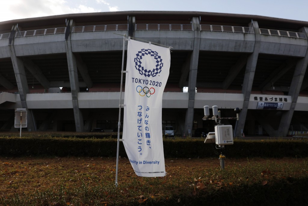 A Tokyo 2020 banner stands in front of the Azuma Baseball Stadium, a venue for baseball and softball at the Tokyo 2020 Olympics, Saturday, Nov. 30, 20...