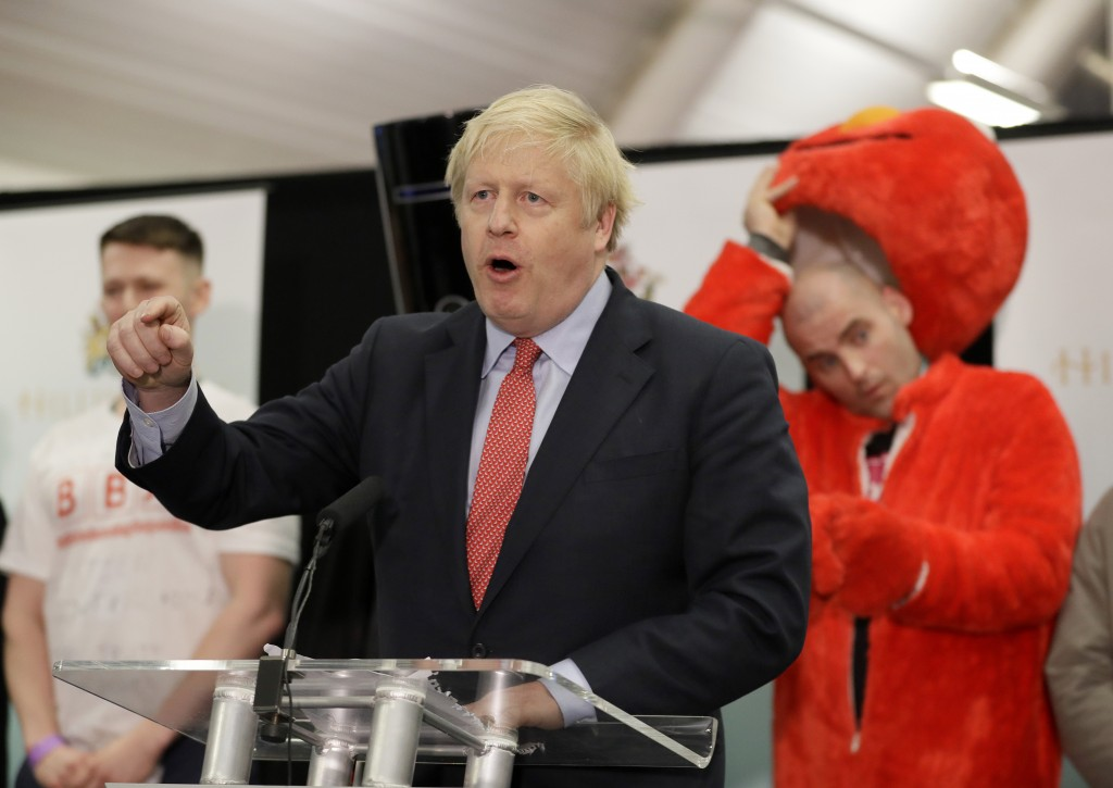 Bobby Smith, a political and fathers' rights activist and founder and leader of the 'Give Me Back Elmo' party watches as Britain's Prime Minister and ...