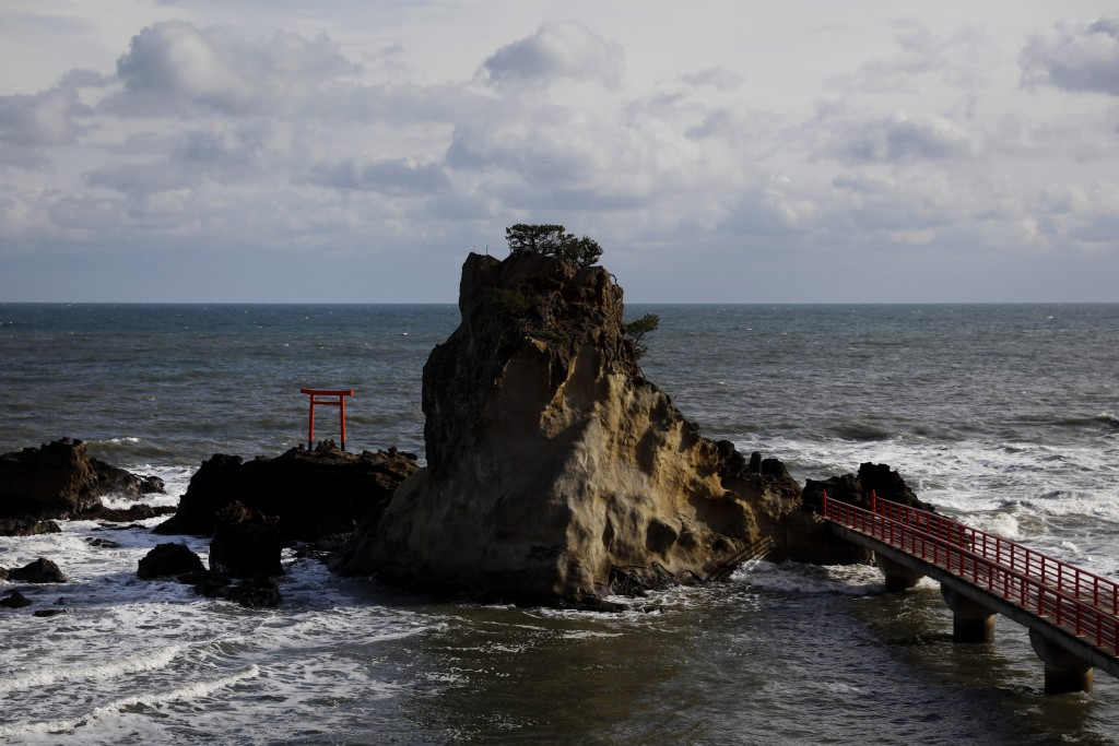 A torii gate stands on a small island Thursday, Nov. 28, 2019, in Iwaki, Fukushima prefecture, Japan. The tori gate survived the March 2011 earthquake...