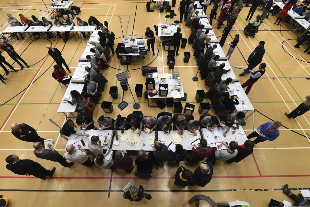 Ballot papers cast in the 2019 general election are counted in Islington in London, Thursday, Dec. 12, 2019. An exit poll in Britain's election projec...