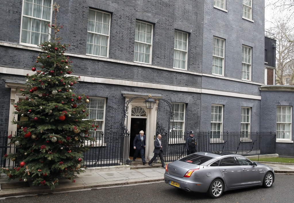 Britain's Prime Minister Boris Johnson leaves number 10 Downing Street in London, Friday, Dec. 13, 2019 on his way to meet Queen Elizabeth II to seek ...