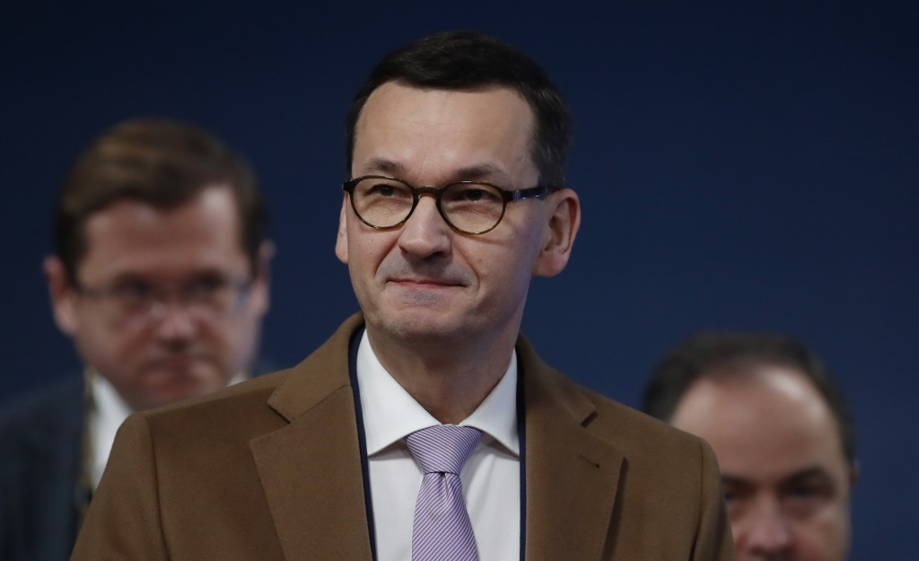 Polish Prime Minister Mateusz Morawiecki arrives for an EU summit in Brussels, Friday, Dec. 13, 2019. European Union leaders are gathering Friday to d...